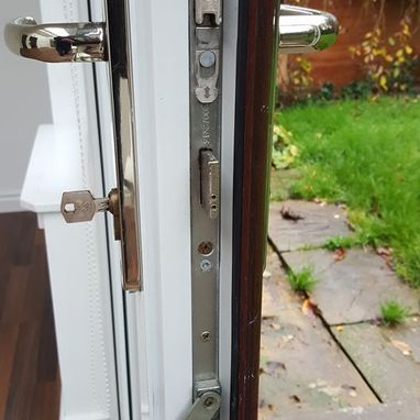 a locking mechanism on the side of a door